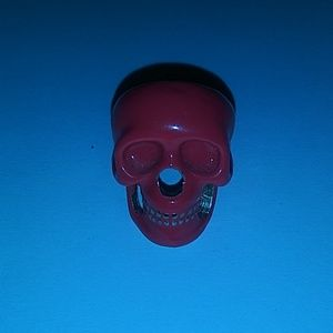 Pink and gold skull ring